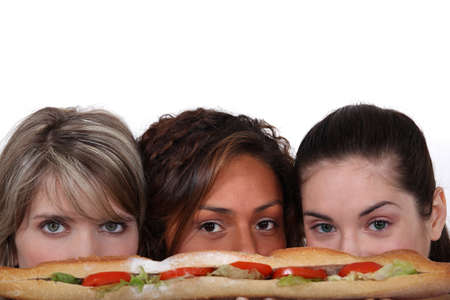 eyeing: Young woman eyeing a sandwich Stock Photo
