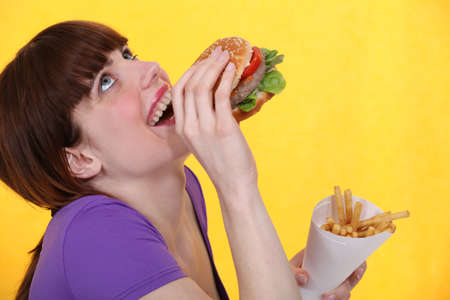 french bread: girl ecstatic over hamburger meal with fries