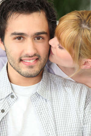 Affectionate couple at home photo