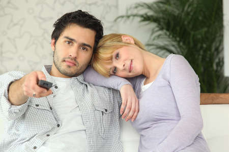 Couple watching television Stock Photo - 14002233