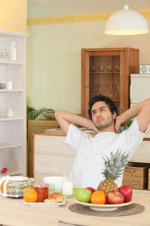 Man relaxing during breakfast photo