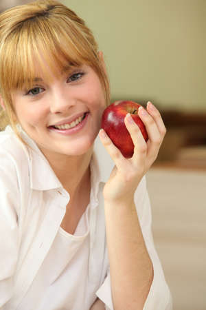 gleeful: Portrait of a woman with an apple