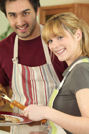 Couple cooking meat Stock Photo - 13990124