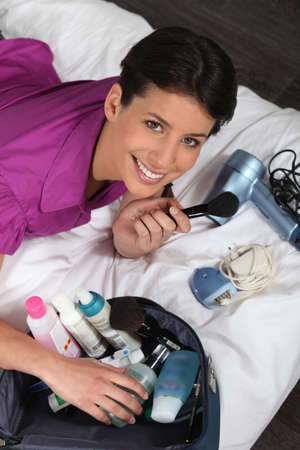 toiletry: Woman unpacking beauty essentials