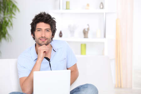 30 years old man with laptop at home photo