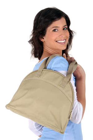 all smiles: brunette all smiles with handbag