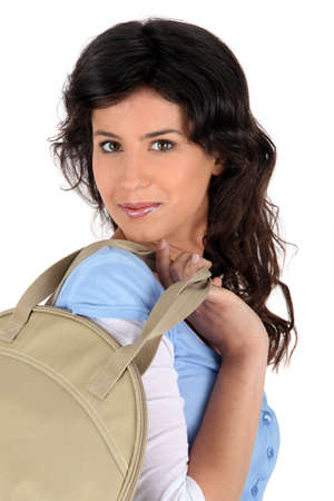 commodious: young woman carrying a handbag Stock Photo