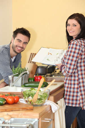home cooked: Couple preparing home cooked meal