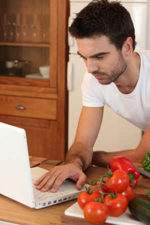 seriously: young searching recipe on the Internet Stock Photo
