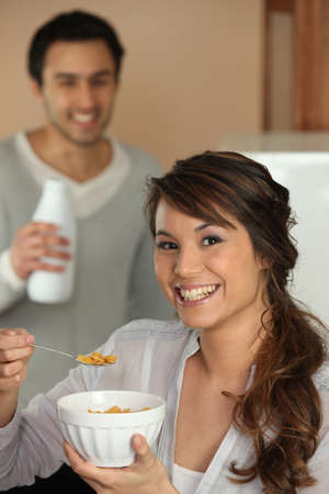 Woman eating cereal for breakfast photo