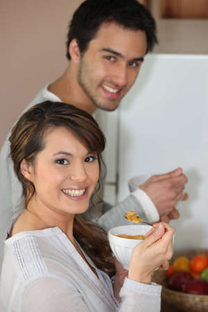 Couple having breakfast standing up photo