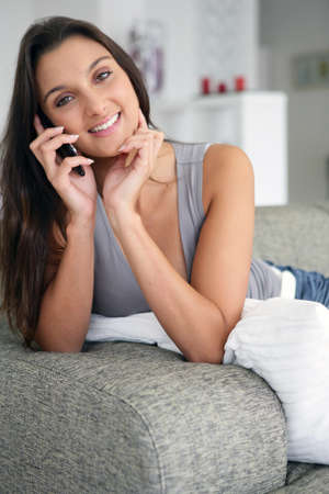 cordless: Brunette gossiping to friends over the phone
