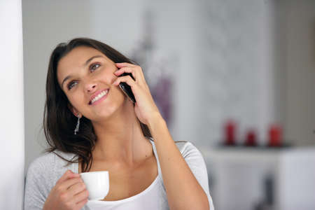 Woman on the phone at home photo