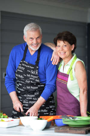 Married couple cooking together on the terrace photo