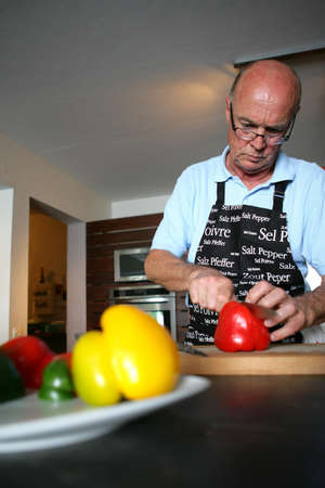 Man cutting peppers Stock Photo - 13951581