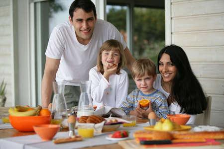 family eating: Family having breakfast outdoors