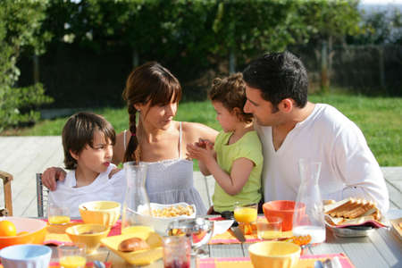 backyards: Family having brunch outside on a sunny day