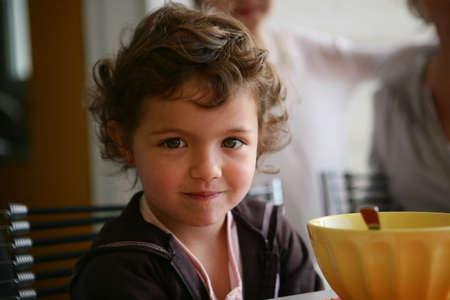 Little girl sat at the breakfast table Stock Photo - 13947529