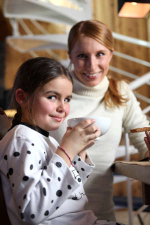 Mother and daughter having a snack Stock Photo - 13951230