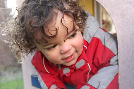 playhouse: Little boy playing in playhouse