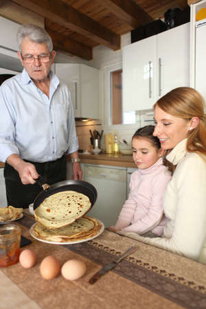 Family about to eat pancakes Stock Photo - 13950874