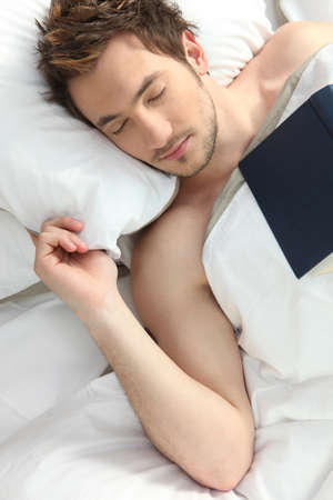 Man who fell asleep reading a book photo
