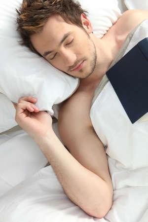 Man who fell asleep reading a book photo