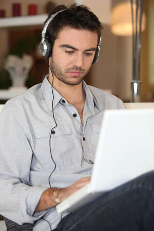 Man listening to his music Stock Photo - 13967277