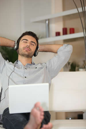 laid back: Man  listening to music