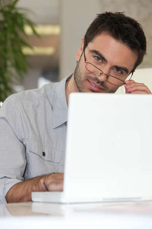 Man with glasses in front of computer Stock Photo - 13967263