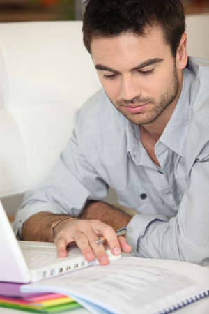speculating: Man using portable computer Stock Photo