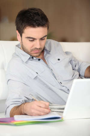Man studying from home photo