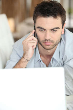 stubble: Serious man looking at laptop Stock Photo