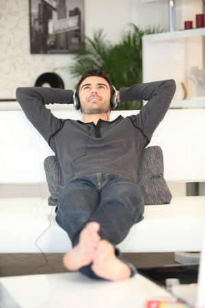 Man relaxing on a sofa Stock Photo - 13961585