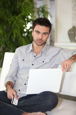 glum: Man using his credit card