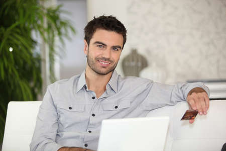Man making online purchase photo