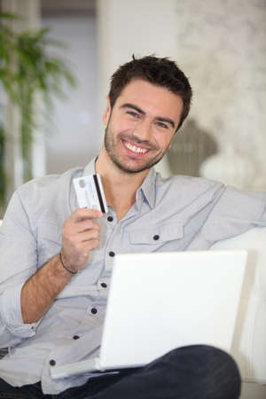 Man with credit card photo