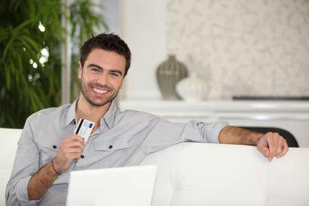 Man using credit card online Stock Photo - 13967231