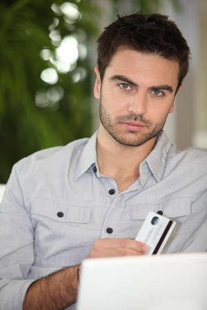 Man shopping on the internet Stock Photo - 13967320