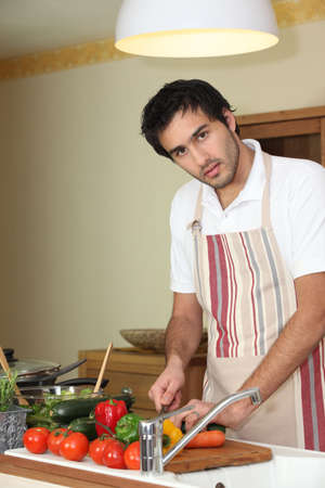bowl sink: Young man preparing a healthy meal to eat