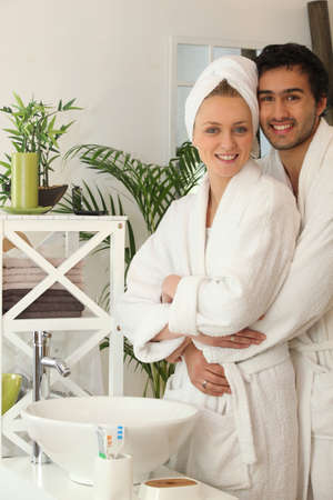 young couple together in the bathroom photo
