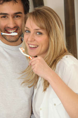 smoother: Couple brushing their teeth Stock Photo