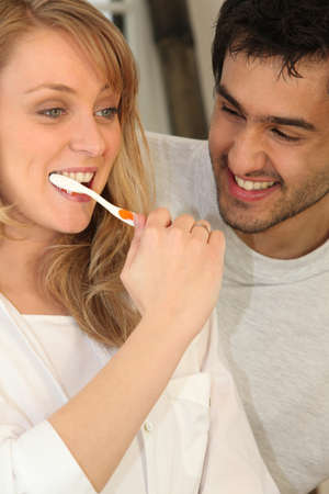 tooth decay: Couple brushing teeth Stock Photo
