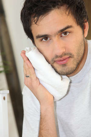 Man drying face with towel Stock Photo - 13988670
