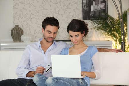 couple shopping on the Internet photo