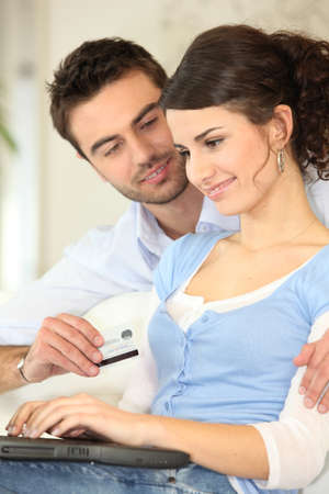 Couple shopping online Stock Photo - 13961579