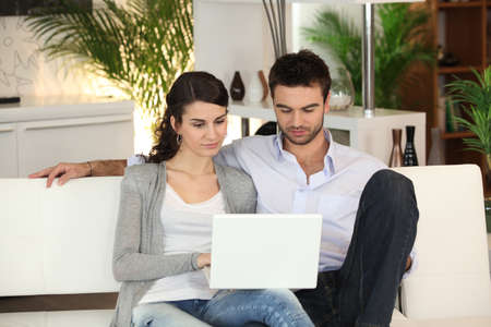 happy young couple at home Stock Photo - 13967273