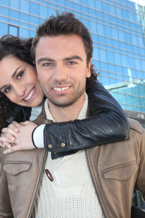 piggyback ride: Couple in front of a building Stock Photo