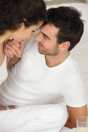 stubble: Young couple on the bed