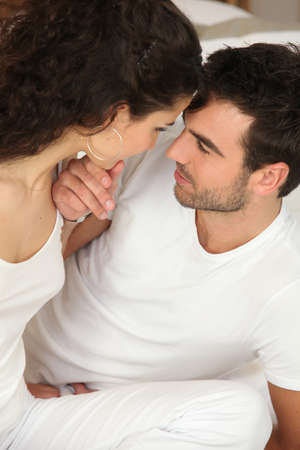 tenderly: Man and woman staring at each other tenderly